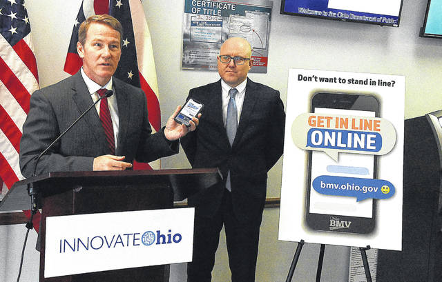 "Lt. Gov. Jon Husted, left, along with Ohio Bureau of Motor Vehicles Registrar Charles Norman make an announcement Tuesday regarding the expansion of the ""Get In Line, Online"" system. Gov. DeWine and Husted previously announced ""Get In Line, Online"" as a pilot project in June 2019, and the system is now rolling out statewide."