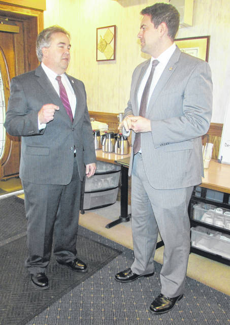 From left are Tony Schroeder, Putnam County GOP chair, and Sen. Rob McColley speaking at the Ottawa Area Chamber of Commerce meeting Tuesday.