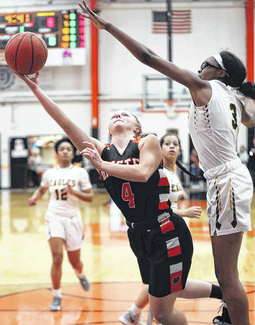 Minster's Ivy Wolf. here putting up a shot against Toledo Christian's Madison Royal-Davis during a Division IV regional semifinal last week at the Elida Fieldhouse, was named the Midwest Athletic Conference player of the year and is averaging 19.1 points, 4.5 steals and 3.7 assists per game.