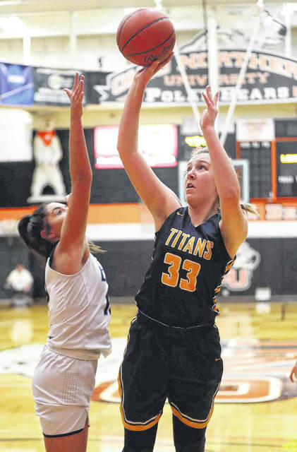 Ottawa-Glandorf's Erin Kaufman puts up a shot against Millbury Lake's Hayley St. John during a Tuesday night Division III regional semifinal at Ohio Northern's King Horn Center in Ada.