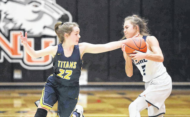 Ottawa-Glandorf's Brianna Schimmoeller (22) defends Millbury Lake's Ava Ayers during a Tuesday night Division III regional semifinal at Ohio Northern's King Horn Center in Ada.
