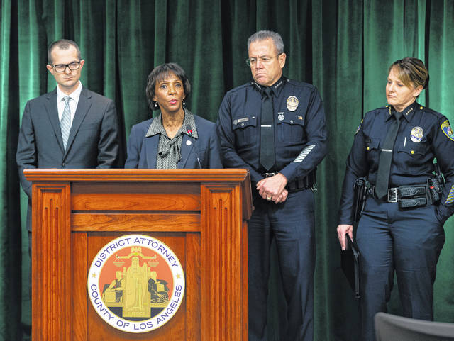 From left, Shawnee High School graduate Paul Thompson, a deputy district attorney for Los Angeles County, joins Jackie Lacey, District Attorney for Los Angeles County; Michel Moore, Chief of the Los Angeles Police Department; and Sandra Spagnoli, Chief of Police for Beverly Hills, Calif.; during a press conference Jan. 6. Thompson is serving as the lead prosecutor in the Los Angeles case against film producer Harvey Weinstein for allegedly raping a woman and sexually assaulting another in separate incidents over a two-day period in 2013.