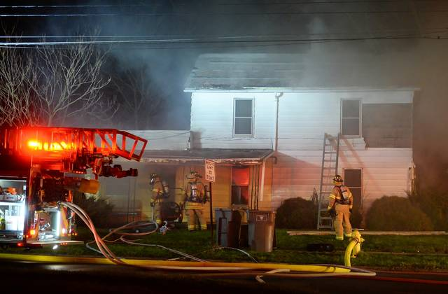 Lima Fire Department were on the scene of a house fire at 402 North Pine Street at 12:30 a.m. Friday morning.  Richard Parrish | The Lima News