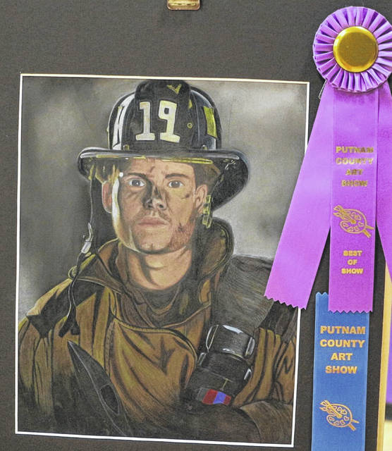 Abi Reyna, an 11th grader from Miller City-New Cleveland, won a Best of Show Award for her colored pencil drawing of a firefighter.