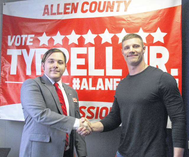 Quentin Poling, right, Las Vegas Raider and former Ohio University standout, shakes hands with his childhood friend Alan D. Tyrrell Jr., who is running for Allen County commissioner, during an event Friday in Gomer.