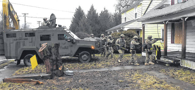SWAT Team members run a practice drills at 537 W. Grand Ave. in Lima on Tuesday morning. The SWAT Team was training with apparatus on the new ERV and also training on more routine tasks. The vacant training house was provided by Allen County Auditor Rachael Gilroy prior to its destruction in compliance with the Allen County Land Bank.