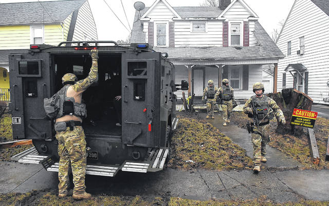SWAT Team members run a practice drills at 537 W. Grand Ave. in Lima on Tuesday morning. The SWAT Team was training with apparatus on the new ERV and also training on more routine tasks.