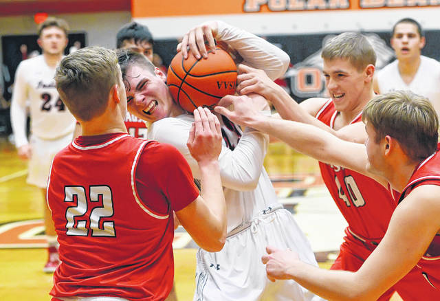 Shawnee's George Mangas protects the ball against Wauseon's Connar Penrod, left, and Isaac Wilson, and Sean Brock during Wednesday's Division II District Semifinal game at ONU Sport Center in Ada.