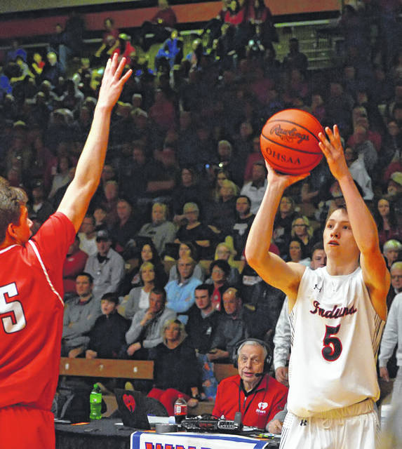 Shawnee's Jarin Bertke shoots against Wauseon's Jonas Tester during Wednesday's Division II District Semifinal game at ONU Sport Center in Ada.