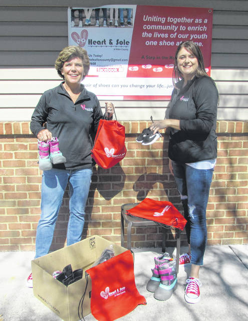 From left are Kim and Kandi Graham, founders of Heart and Sold of Allen County, an organization whose goal is to provide every child in the Lima city school system with needed tennis shoes, sandals and winter boots.