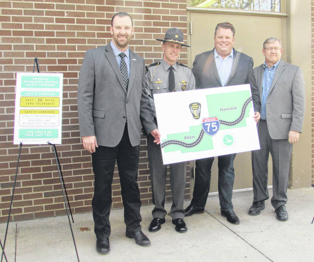 From left are Chris Hughes, deputy director of ODOT District 1, Captain John Altman, Ohio State Highway Patrol Findlay district commander, and Jon Cross and Bob Cupp, state representatives. They were on hand to announce a distracted driving safety corridor on Interstate 75 in northern Allen and southern Hancock counties.