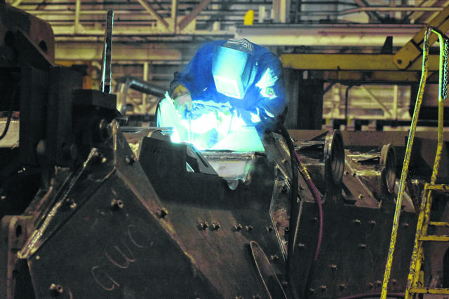 An employee at the Joint Systems Manufacturing Center welds at the facility.