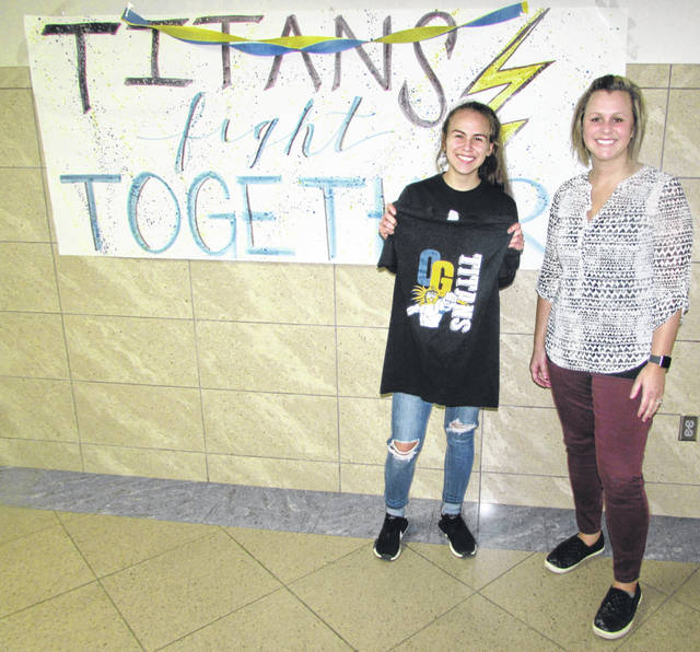 From left are Ottawa-Glandorf High School Senior Amiah Lopez with her winning T-shirt design and her art teacher Laura Myers.