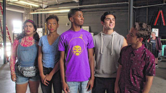 "This image released by Netflix shows, from left, Jessica Marie Garcia, Sierra Capri, Brett Gray, Diego Tinoco and Jason Genao from the series ""On My Block."" The series is an honest portrayal of the realities young adults face growing up in inner-city Los Angeles, and critics have praised the comedy-drama's depiction of four bright, street-savvy friends with nuance and care."