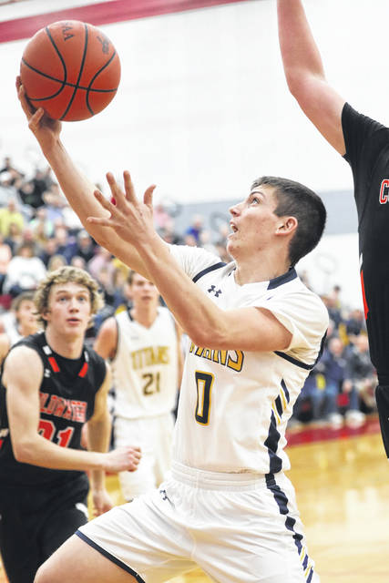 Ottawa-Glandorf's Jarrod Beach puts up a shot during a Division III district semifinal against Coldwater at Lima Senior. Amanda Wilson | The Lima News