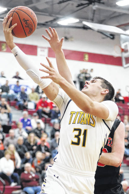 Ottawa-Glandorf's Ben Westrick puts up a shot during a Division III district semifinal against Coldwater at Lima Senior. Amanda Wilson | The Lima News