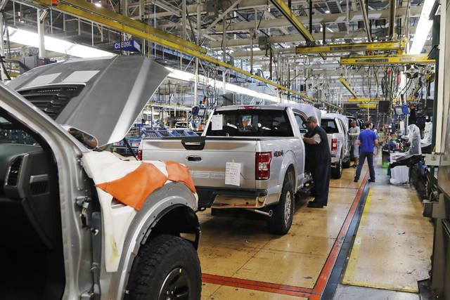 Detroit's three automakers have agreed to close all North American factories due to worker fears about the coronavirus, two people briefed on the matter said Wednesday. (AP Photo/Carlos Osorio, File)