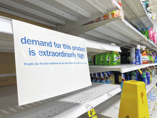 Empty shelves at Meijer on Elida Road were marked with signage Saturday.