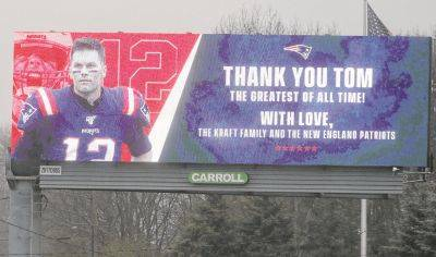 A billboard featuring an image of former New England Patriots quarterback Tom Brady stands Thursday along Route 1, in Walpole, Mass., about a mile from Gillette Stadium, which is in Foxborough, Mass.