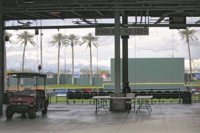 Goodyear Ballpark, spring training home of the Cleveland Indians and Cincinnati Reds baseball teams, is empty last week in Goodyear, Ariz., after Major League Baseball suspended the rest of its spring training game schedule because of the coronavirus outbreak.