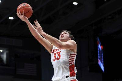 St. Henry graduate Ryan Mikesell (33) is a member of the Dayton team that finished No. 3 in the final Associated Press Top 25 poll. (AP photo)