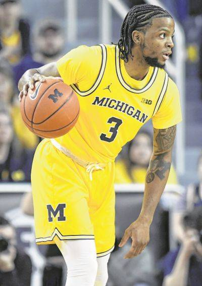 Michigan guard Zavier Simpson dribbles against Nebraska during the first half of an NCAA college basketball game, Thursday, March 5, 2020, in Ann Arbor, Mich. (AP Photo/Jose Juarez)