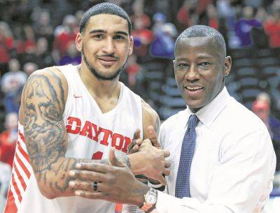 The Dayton Flyers coached by Anthony Grant, right, that starred Obi Toppin, left, went 29-2 this season and finished No. 3 in the final Associated Press Top 25 poll.