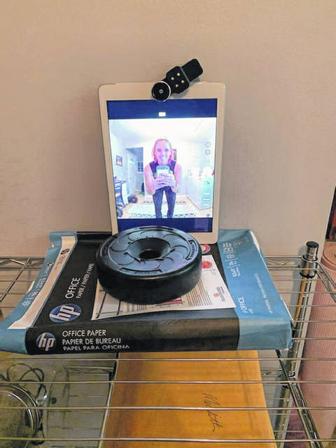 Meredith Reiber of Anytime Fitness in Lima set up a camera in her laundry room to conduct an in-person live exercise class Saturday morning.