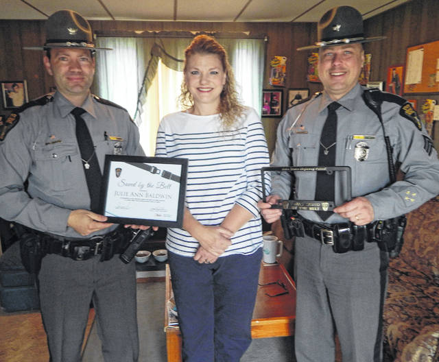 "Pictured, from left, are Ohio State Highway Patrol Trooper J. Coffey, ""Saved by the Belt"" award-winner Julie Baldwin and Sgt. M. Shay Seabolt of the Wapakoneta patrol post."
