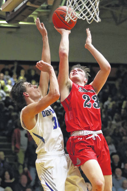 Shawnee's George Mangas puts up a shot against Defiance's Caden Kline during Saturday night's Division II district final at Ohio Northern University in Ada.