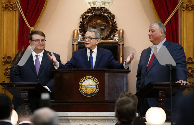 Ohio Governor Mike DeWine, center, speaks between Ohio Senate President Larry Obhof, left, and Ohio House Speaker Larry Householder during the Ohio State of the State address at the Ohio Statehouse in Columbus in early March. Lawmakers plan to address the disrupted school year and the postponed Ohio primary when they return to Columbus on Wednesday and Thursday. (AP Photo/Paul Vernon, File)
