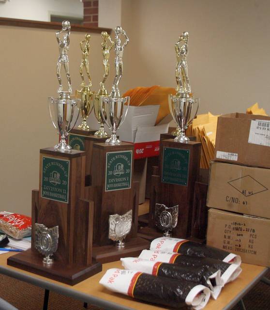 The 2020 state basketball championship trophies remain in a room in the Ohio High School Athletic Association offices. The tournaments are in jeopardy of not being completed.