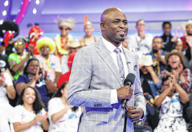 """Host Wayne Brady walks down the aisle of the game show """"Let's Make a Deal."""" Shut-in television viewers tuned in to """"Deal"""" in record numbers last week. The Nielsen company said the show recorded its best week in the 11 years since it was revived by CBS with Wayne Brady as host."""