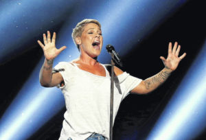 Singer Pink says she had COVID-19, gives $1M to relief funds