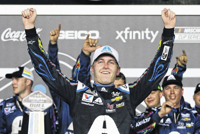 FILE - In this Feb. 13, 2020, file photo, William Byron celebrates after winning the second of the two NASCAR Daytona 500 qualifying auto races at Daytona International Speedway in Daytona Beach, Fla. Byron won his second consecutive NASCAR virtual race Sunday, April 19, 2020, by holding off Timmy Hill — the driver who moved him out of the way to win an earlier iRacing event — in a race finally low on dramatics. (AP Photo/Terry Renna, File)