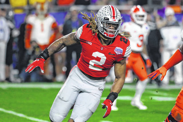 FILE - In this Dec. 28, 2019, file photo, Ohio State defensive end Chase Young (2) moves in on the play during the first half of the Fiesta Bowl NCAA college football game against Clemson, in Glendale, Ariz. Young is a likely first round pick in the NFL Draft Thursday, April 23, 2020. (AP Photo/Rick Scuteri, File)