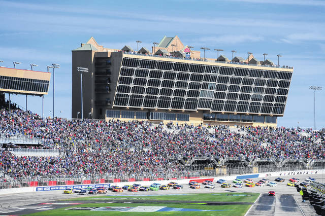 In this Feb. 24, 2019, file photo, a NASCAR Monster Energy NASCAR Cup Series auto race starts at Atlanta Motor Speedway in Hampton, Ga. NASCAR and IndyCar have each called off their races this weekend. NASCAR was scheduled to run Sunday at Atlanta Motor Speedway without spectators but said Friday, March 13, 2020, it is calling off this weekend and next week's race at Homestead-Miami Speedway. IndyCar was scheduled to open its season Sunday on the streets of St. Petersburg, Florida, but suspended it's season through the end of April.