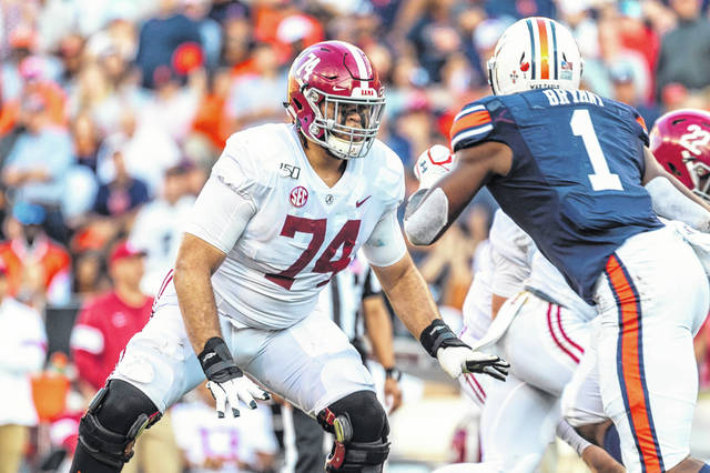 FILE - In this Nov. 30, 2019, file photo, Alabama offensive lineman Jedrick Wills Jr. (74) sets up to block against Auburn defensive lineman Big Kat Bryant (1) during the first half of an NCAA college football game in Auburn, Ala. The Cleveland Browns selected Wills in the first round of th NFL draft Thursday, April 23, 2020. (AP Photo/Vasha Hunt, File)