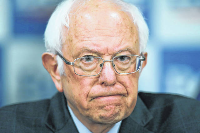 FILE - In this March 12, 2020, file photo Democratic presidential candidate, Sen. Bernie Sanders, I-Vt., speaks to reporters about coronavirus in Burlington, Vt.