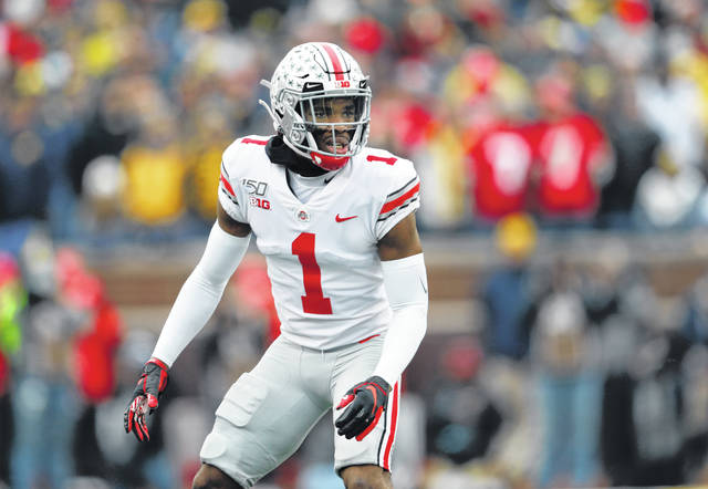 In this Nov. 30, 2019, file photo, Ohio State cornerback Jeff Okudah get ready for a Michigan play during an NCAA college football game in Ann Arbor, Mich. The Detroit Lions selected Okudah with the third pick in the NFL draft Thursday.