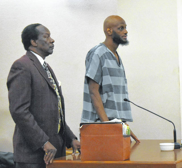 Andrew Smith, right, accompanied by his attorney Jerry Pitts, addresses the court in his sentencing held Friday morning.