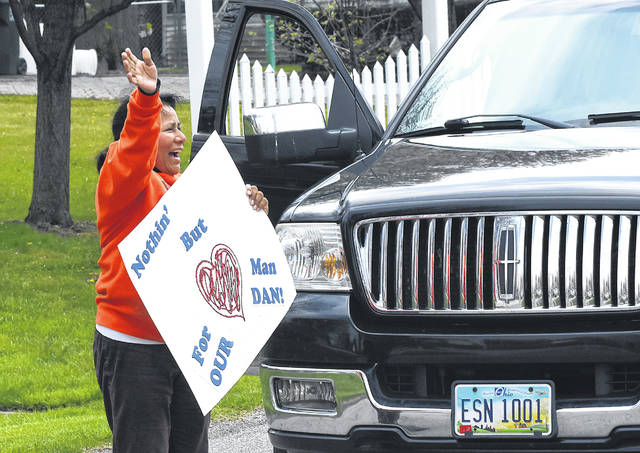 """A supporter waves while holding a sign reading """"Nothin' but heart for our man dan!"""" on Friday. See more photos on LimaOhio.com."""