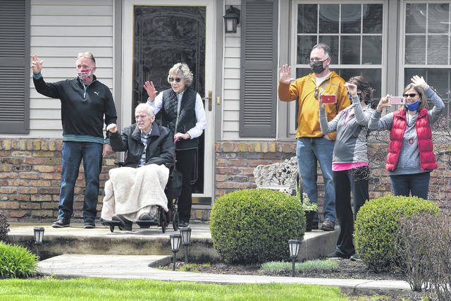 Former Allen County commissioner Dan Reiff waves to participents of a Ԅrive Byՠpast his home in Elida. Staff at Allen County Children Services (ACCS) and employees from various Allen County offices came together Friday afternoon for a drive by demonstration of support and encouragement for Mr.Dan Reiff. Craig J. Orosz | The Lima News