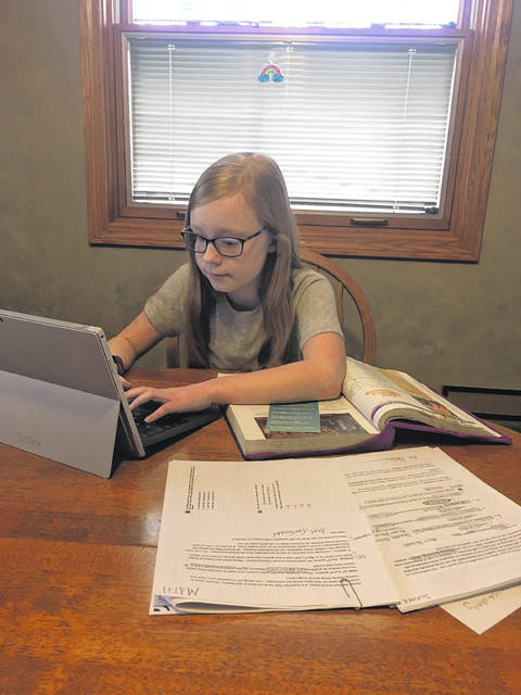 Morgan Bockrath, daughter of Dawn and Doug, works on her daily assignments at home. She is a fifth grader at Kalida Middle School.