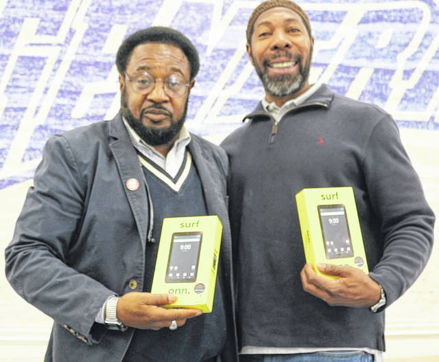 Derry Glenn, Lima's 6th Ward councilor, presented 20 computer tablets Sunday to Dr. Willie Heggins, of Heir Force Community School.
