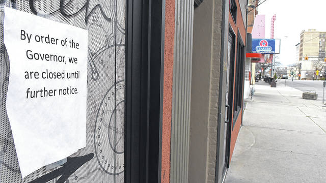 A closed sign is placed on a local bar and restaurant in downtown Lima as Ohio Gov. Mike DeWine lays out a plan to open the state.