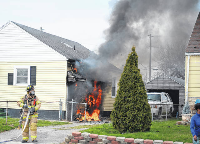 Lima Fire Department respond to a house fire at 615 E. Fourth Street Saturday evening.  Richard Parrish | The Lima News