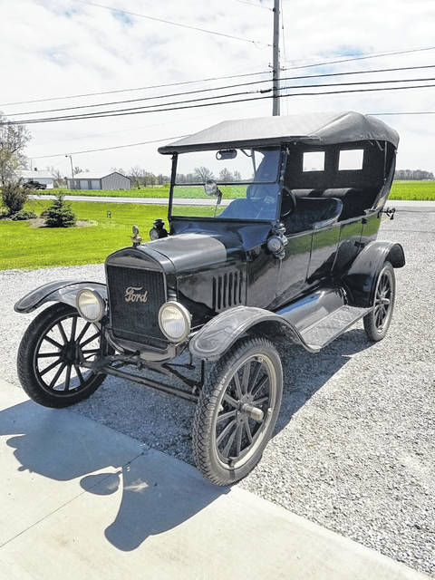 "Randy Roof's love of the Model T started with his father's collection of antiques. ""We have fun with them,"" Roof said."