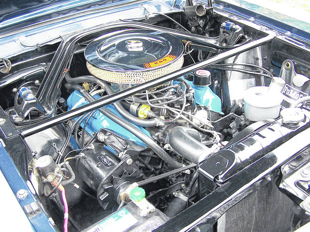The green button at the front is where the generator is in this 1964 1/2 Ford Mustang. Early models like this had a generator, not an alternator.