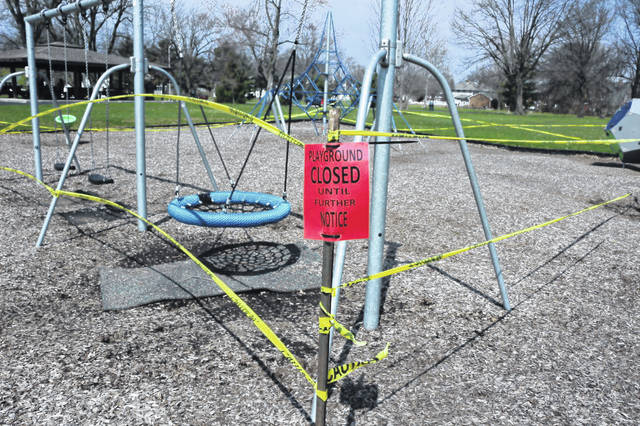 While people can enjoy Lima parks, the playground equipment is off-limits due to the COVID-19 pandemic.